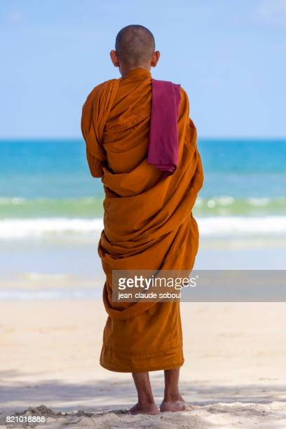 Monk, standing on the beach, in Sihanoukville city (Cambodia)