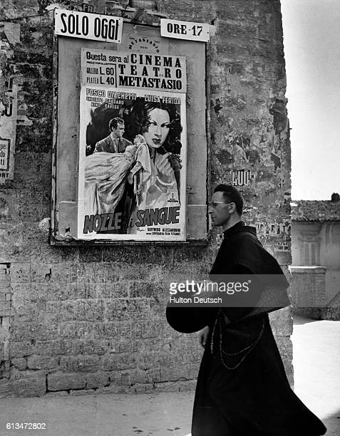 A monk strolls down a street in Assisi The poster advertising a film adds a garish note in this old town St Francis made Assisi famous and because of...