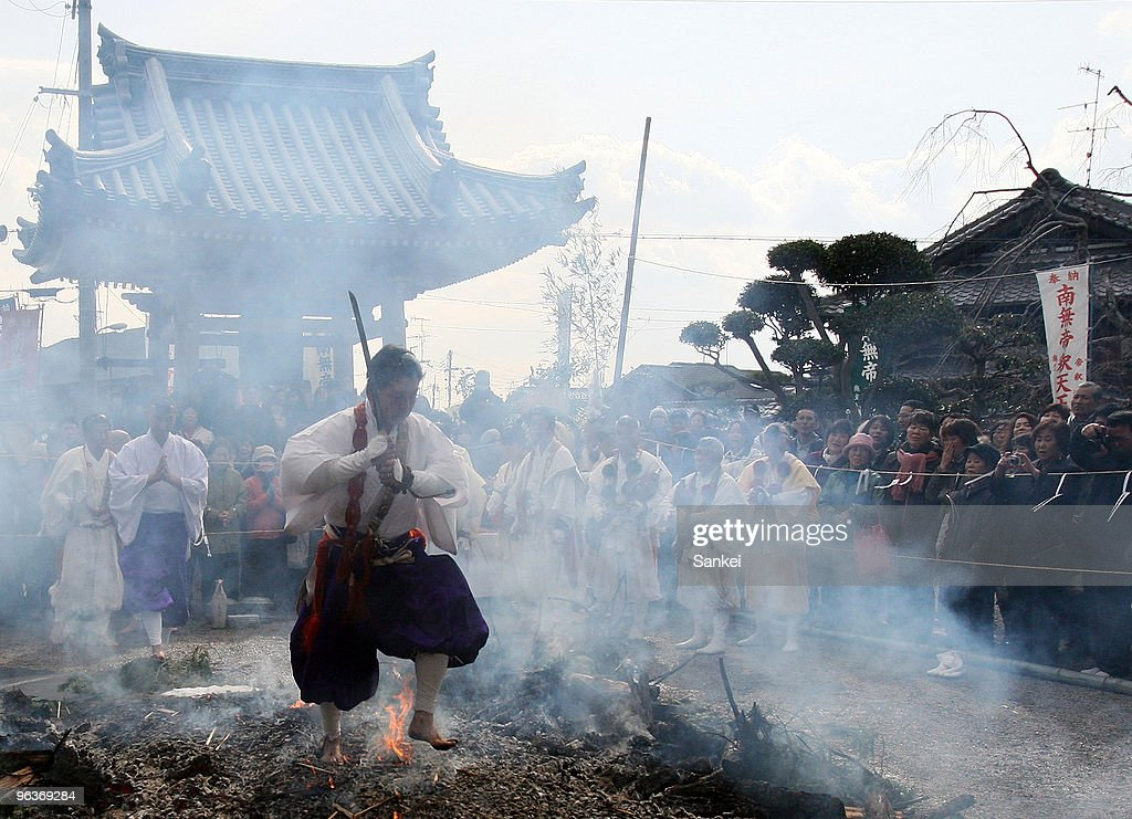 A monk walk barefoot on fire during the walking-over-fire ceremony at Taishakuji Temple on February 2, 2010 in Osaka, Japan. People pray for good health by walking on fire with barefoot during the ceremony.