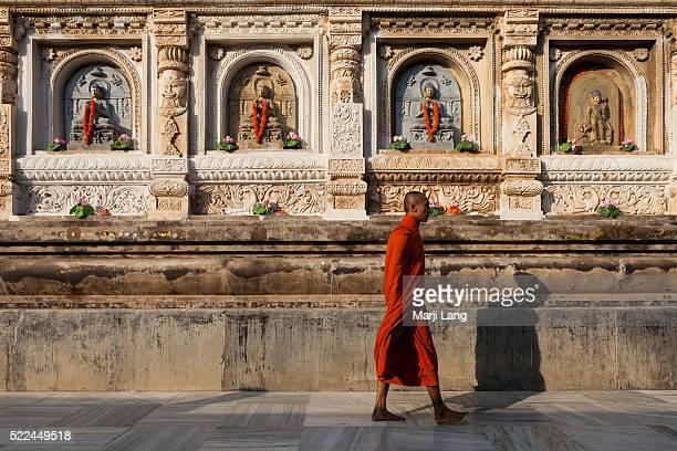 BODHGAYA BIHAR INDIA BODHGAYA BIHAR INDIA A monk walking around the Mahabodhi Mahavihara temple in Bodh Gaya Bihar India 'Great Awakening Temple' is...