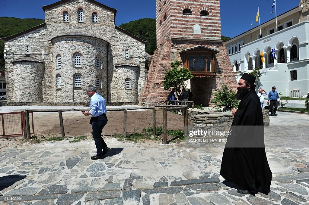 A monk walks in Karyes near the Mount Athos where Russian President Vladimir Putin will visit, on 28 May, 2016. Russian President is visiting Mount Athos in Greece to mark the 1,000-year presence of Russian Orthodox monks there. Russian President Vladimir Putin signed several economic deals with Athens on on May 27, 2016 during a visit to Greece aimed at reinforcing a relationship with one of his few friends in the EU amid tensions with the West. MITROLIDIS