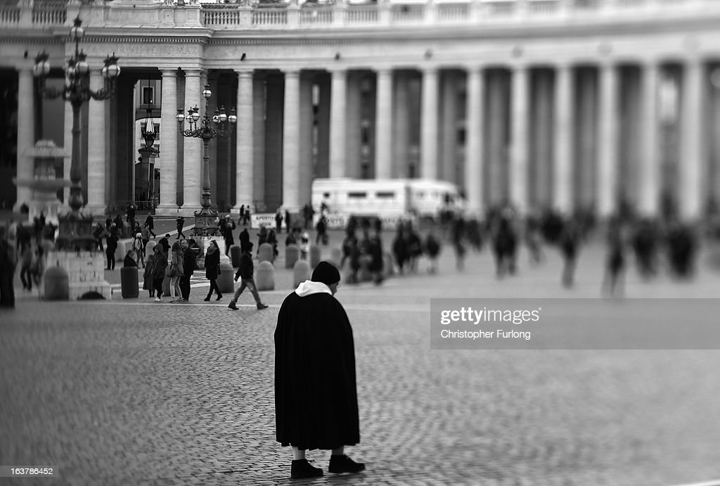 . A monk walks through across St Peter's Square on March 15, 2013 in Vatican City, Vatican. Daily life continues around the vatican as romans prepare for the inauguration mass of Pope Francis, the first ever Latin American Pontiff.