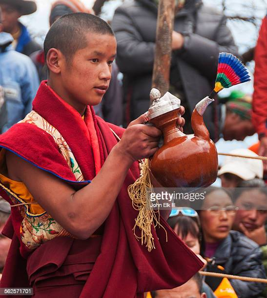 Monk with ritual pitcher