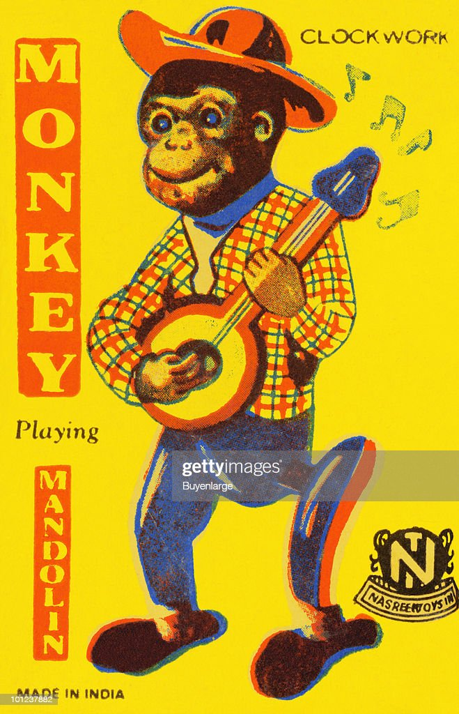 A monkey plays the mandolin on this tin toy box lid