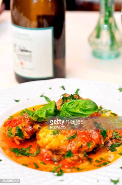 Monkfish fillets with tomatoes sauce and basil L'Osteria restaurant Cagliari Sardinia Italy Europe