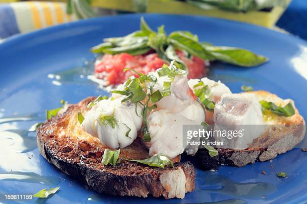 Monkfish with tomatoes and basil