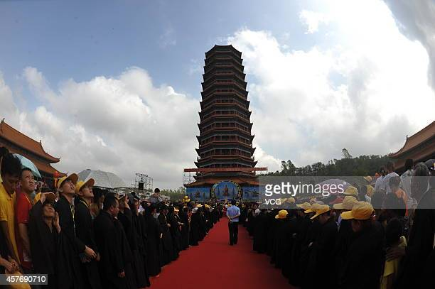 Monks and citizns conduct ceremony of blessings by seeing first light of a Buddhist pagoda at Jinshan Temple on October 22 2014 in Chengmai Hainan...