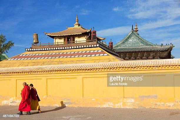 Monks and yellow temple wall, Gandan Monastery