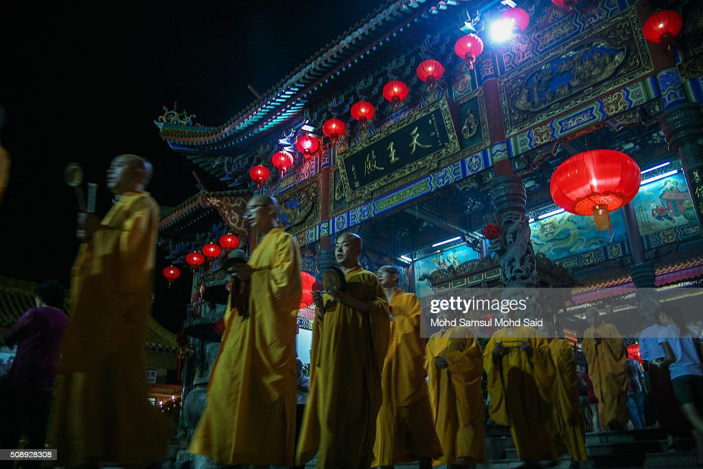 A monks are seen perform a prayers inside the Guan Yin temple ahead of Lunar New Year of the monkey celebrations on February 7, 2016 outside Kuala Lumpur, Malaysia. According to the Chinese Calendar, the Lunar New Year which falls on February 8 this year marks the Year of the Monkey, the Chinese Lunar New Year also known as the Spring Festival is celebrated from the first day of the first month of the lunar year and ends with Lantern Festival on the Fifteenth day.