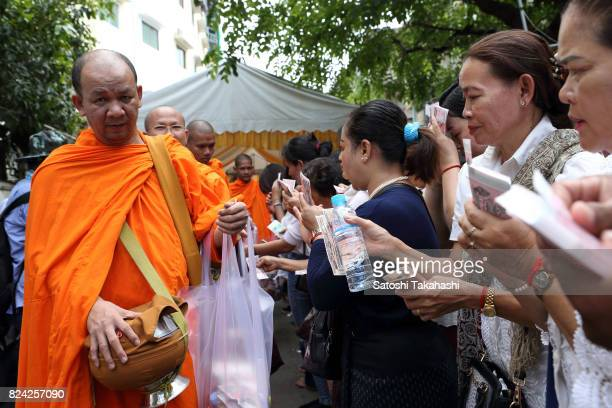Monks ask for alms during a farewell ceremony at Phnom Penh's iconic White Building It was built in 1963 as a modern Municipal Apartment The iconic...