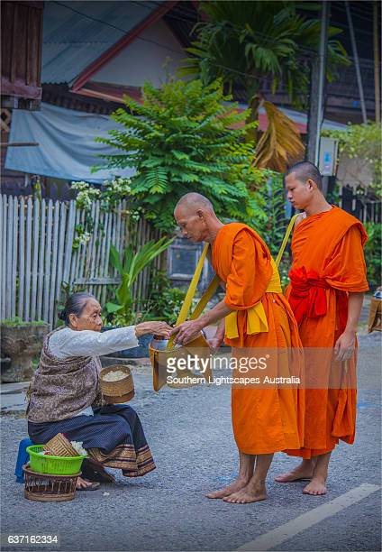 Monks collecting Alms, early morning in Luang Prabang, Laos.
