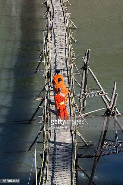 Monks crossing Nam Khan River
