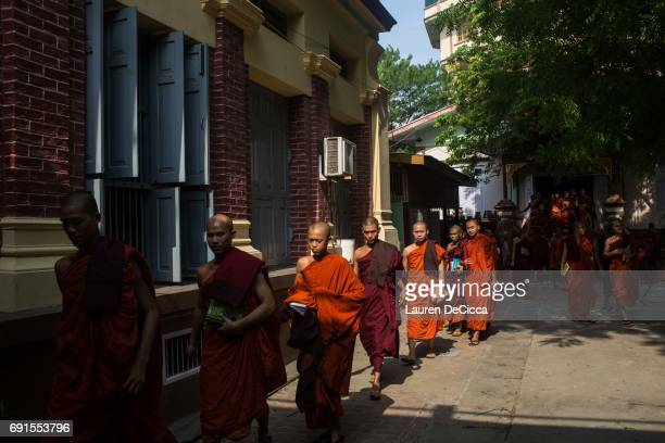 Monks exit their classes at the end of the day at the Masoeyein Monastery home of Wirathu the head of the nationalist Buddhist group in Myanmar on...