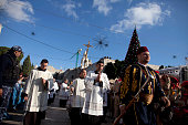 Monks hold up a cross as they parade outside the Church of the Nativity on December 24 2014 in Bethlehem West Bank Every Christmas pilgrims travel to...