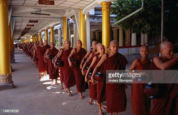Monks line up at Kha Khat Wain Kyaung in Bago.