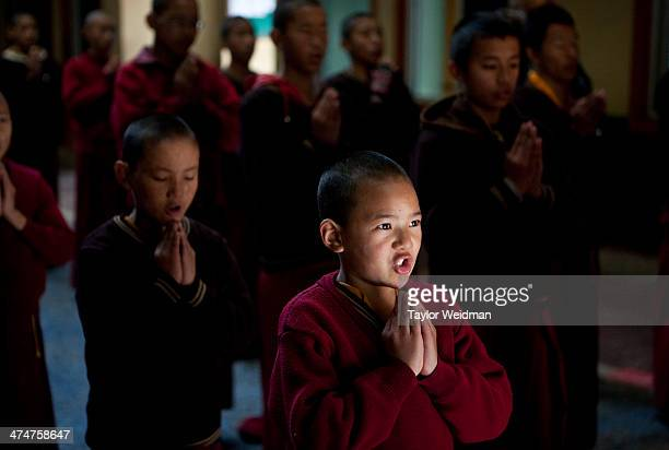 Monks line up for a meeting and prayer before school at a monastery near the Tashi Palkhiel Refugee Camp near Pokhara Nepal is home to at least 20000...