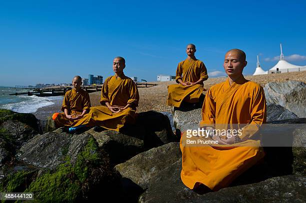Monks meditate on the beach on September 10 2015 in Bognor Regis England The Shaolin Monks have travelled from their temple in the foothills of the...
