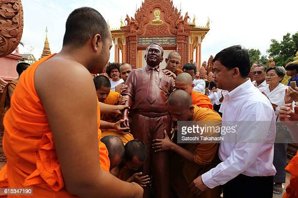 Monks move a statue of prominent political analyst Kem Ley to a ceremonial place from inside a pagoda during his 100day funeral ceremony Kem Ley was...
