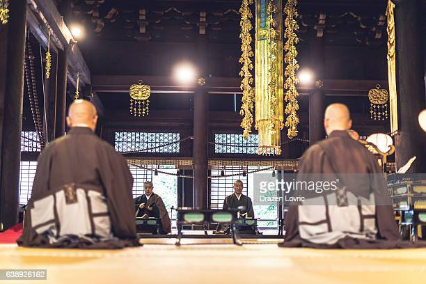 Monks on ceremony in Buddhist Shrine in Kyoto
