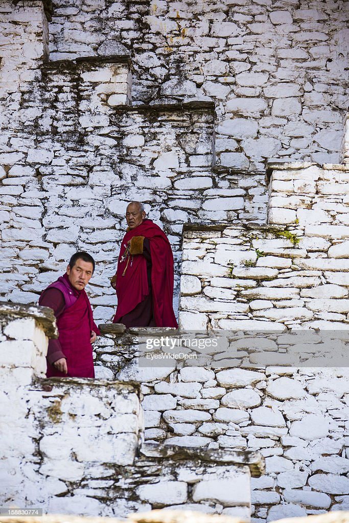 Monks on stairs in the Temple of Kurjey Lhakhang near Jakar on November 18, 2012 in Bumthang, Bhutan.