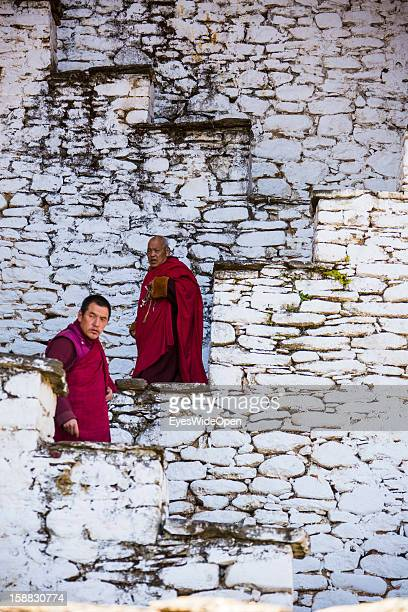 Monks on stairs in the Temple of Kurjey Lhakhang near Jakar on November 18 2012 in Bumthang Bhutan