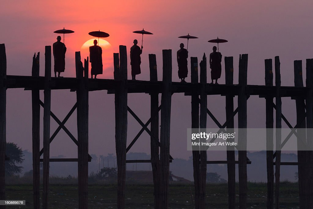 Monks on the U Bein Bridge, Amarapura, Myanmar : Stock Photo