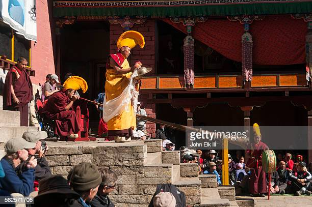 Monks playing giant trumpets and cymbals