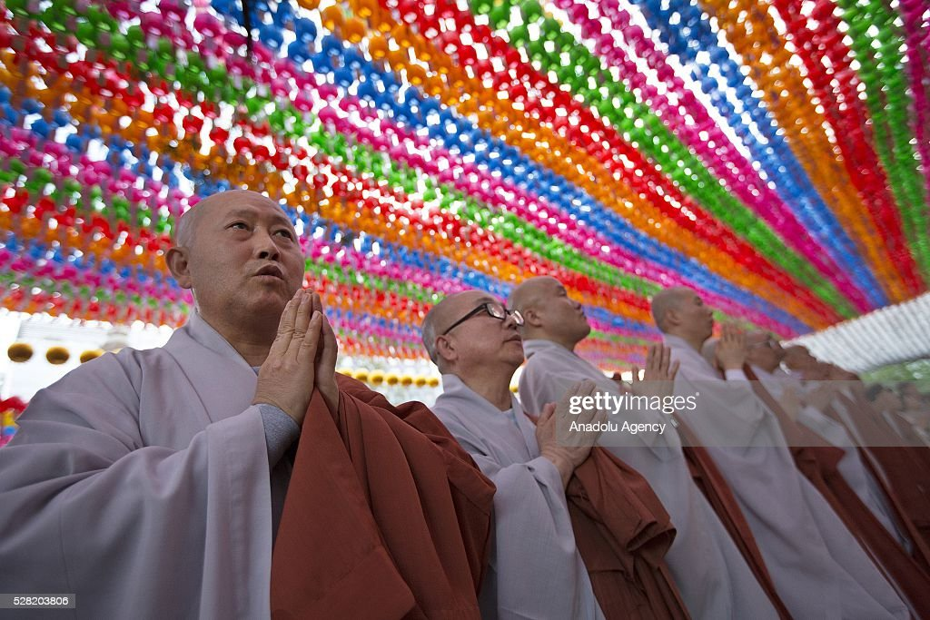 Monks pray under lanterns during a Lighting ceremony for the Lotus Lantern Festival to celebrate Buddha's birthday at the Jogye temple on May 4, 2016 in Seoul, South Korea.