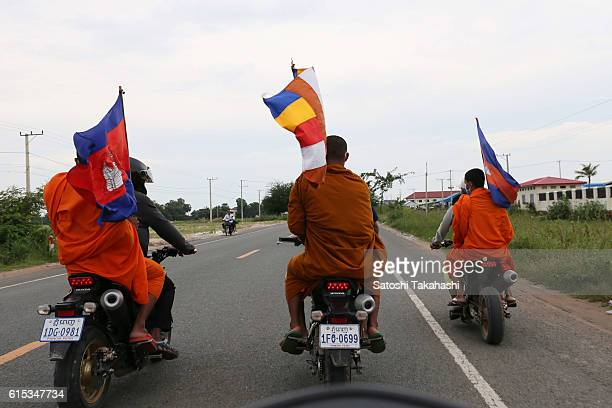 Monks take part in a funeral procession for slain prominent political analyst Kem Ley to mark 100 days since his death They make their way to Ley's...
