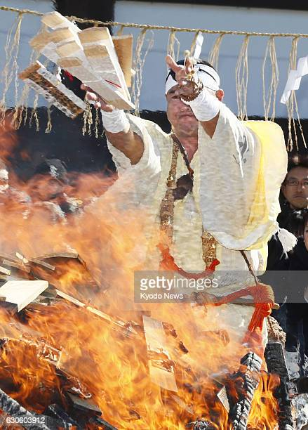 Monks throw charms into a fire during an annual ritual at Shinshoji Temple in Narita near Tokyo on Dec 28 to express appreciation for health to the...