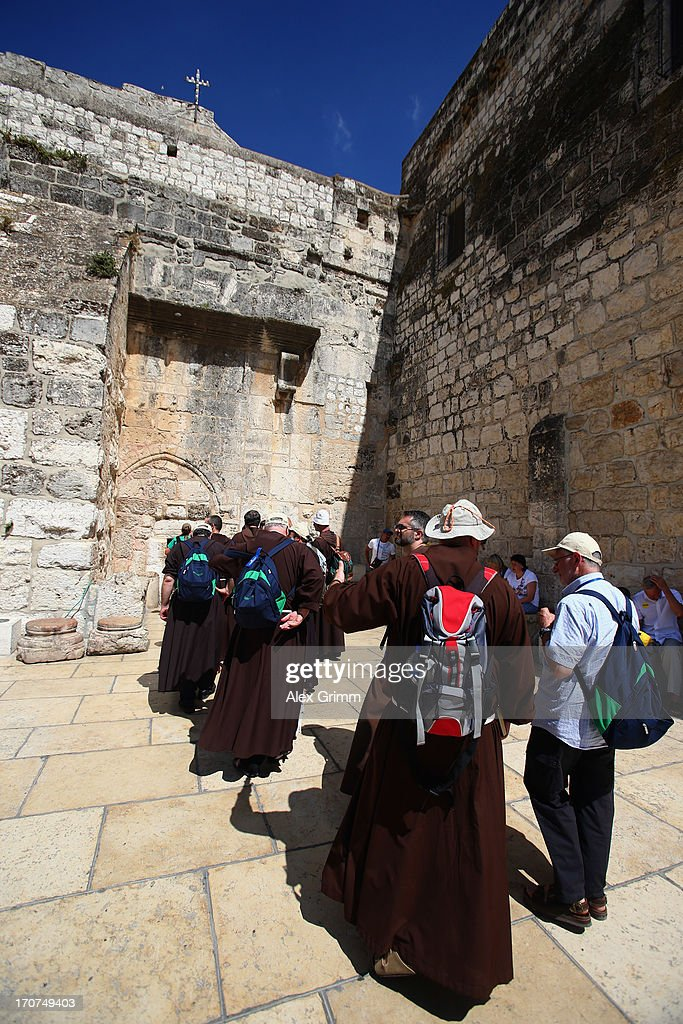 Monks wait in a line to enter the Church of the Nativity on June 16, 2013 in Bethlehem, West Bank.