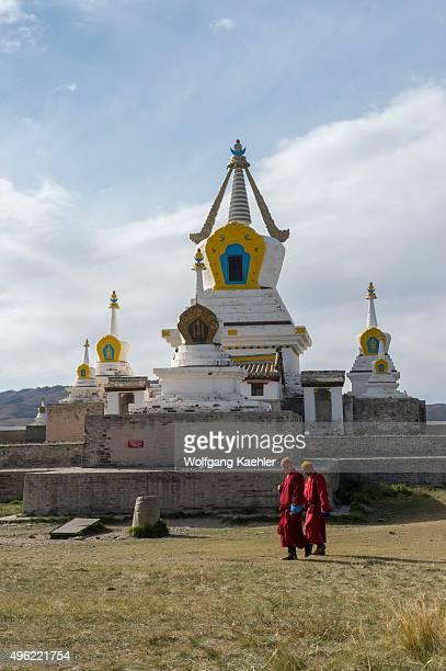 Monks walking in front of the Golden Stupa at the Erdene Zuu monastery in Kharakhorum Mongolia