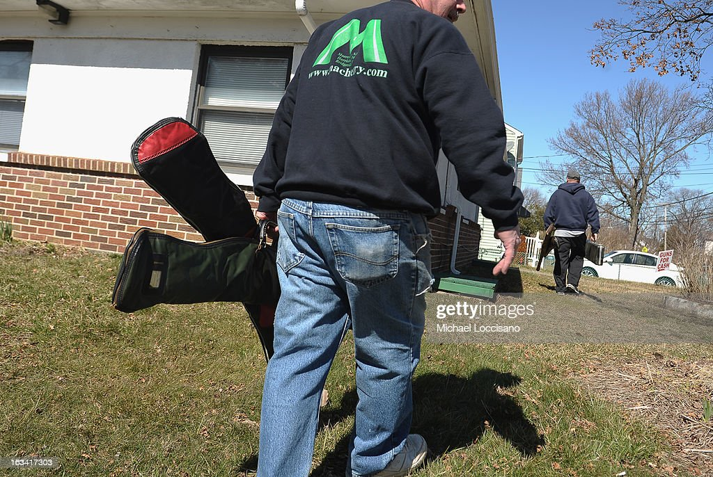 A Monmouth County resident makes his way to turn in firearms during a gun buyback program on March 9, 2013 in Keansburg, New Jersey. In a national effort to curb gun violence, the NJ Attorney General's Office in cooperation with the Monmouth County Prosecutor's Office held an anonymous buyback program where every gun turned in is to be melted down.
