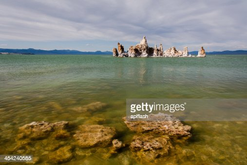 Mono Lake tufa rock in green water : Stock Photo