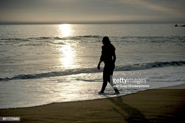 Monochrome woman walking out to sea