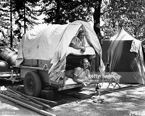 Monon and Ottily Bayer the daughters of Mr and Mrs Otto Bayer of Costamesa California in a small 'bunk bed' trailer at their campground in the Shasta...