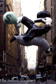 MR Monopoly balloon crossing 36th street and 7th avenue after completing The 77th Annual Macys Thanksgiving Day Parade on November 27 2003 in New...