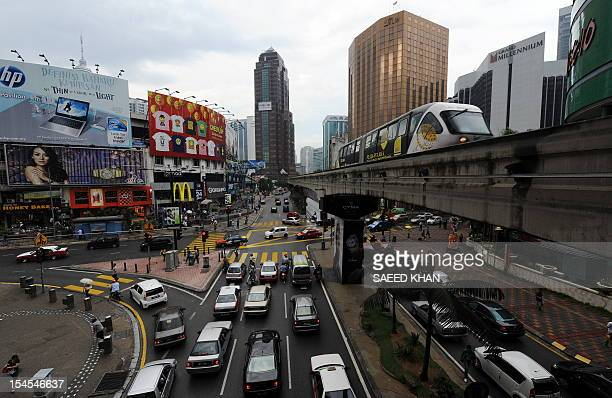 A monorail approaches Bukit Binting station in Kuala Lumpur on January 29 2010 AFP PHOTO/Saeed KHAN