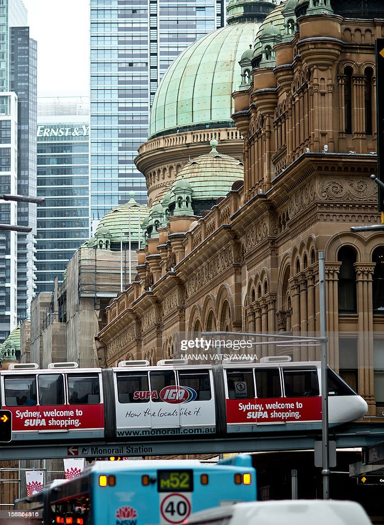 A monorail carriage passes through the city's central business district towards the Darling Harbour in Sydney on January 2, 2013. The popular monorail which transports almost three million people annually, most of them tourists is due to be scrapped and replaced by a lightrail system in 2013. AFP PHOTO/ MANAN VATSYAYANA