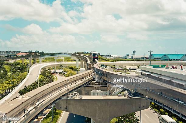 Monorail train on elevated bridge in Okinawa city