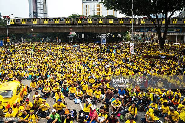 Monorail train operated by Rapid Rail Sdn Bhd travels along an elevated track as protesters gather near Merdeka Square during the Coalition for Clean...