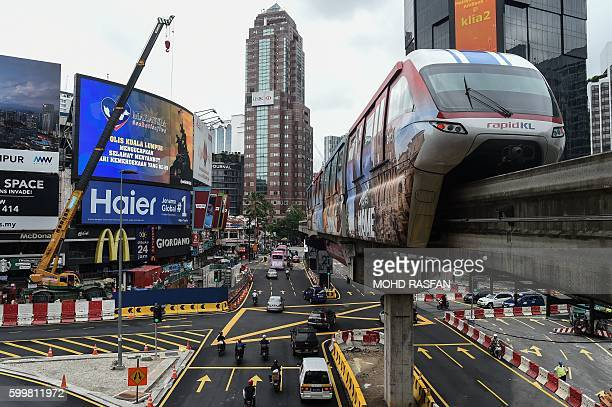 A monorail trains arrives Bukit Bintang station in downtown Kuala Lumpur on September 7 2016 / AFP / MOHD RASFAN