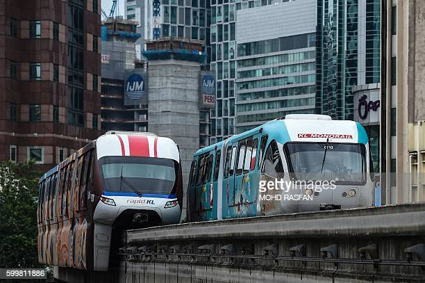 Monorail trains pass each other near the Bukit Bintang station in downtown Kuala Lumpur on September 7 2016 / AFP / MOHD RASFAN
