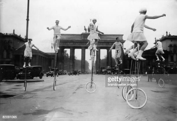 Monowheel performance in front of the Brandenburg Gate in Berlin Photograph Around 1930 [Einradvorfhrung vor dem Brandenburger Tor in...