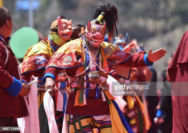 Monpa tribe dancers perform their traditional mask dance on the last day of exiled Tibetan spiritual leader the Dalai Lamas visit at the Yiga Choezin...