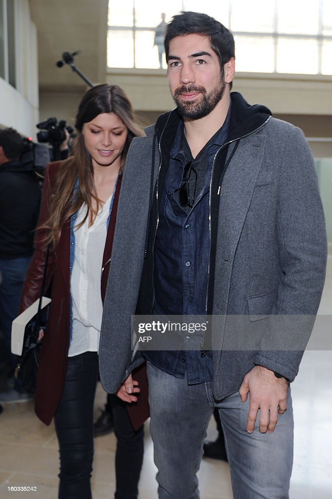 Monpellier handball player Nikola Karabatic and his girlfriend Geraldine Pillet leave Montpellier's courthouse on January 29 after a hearing as part...