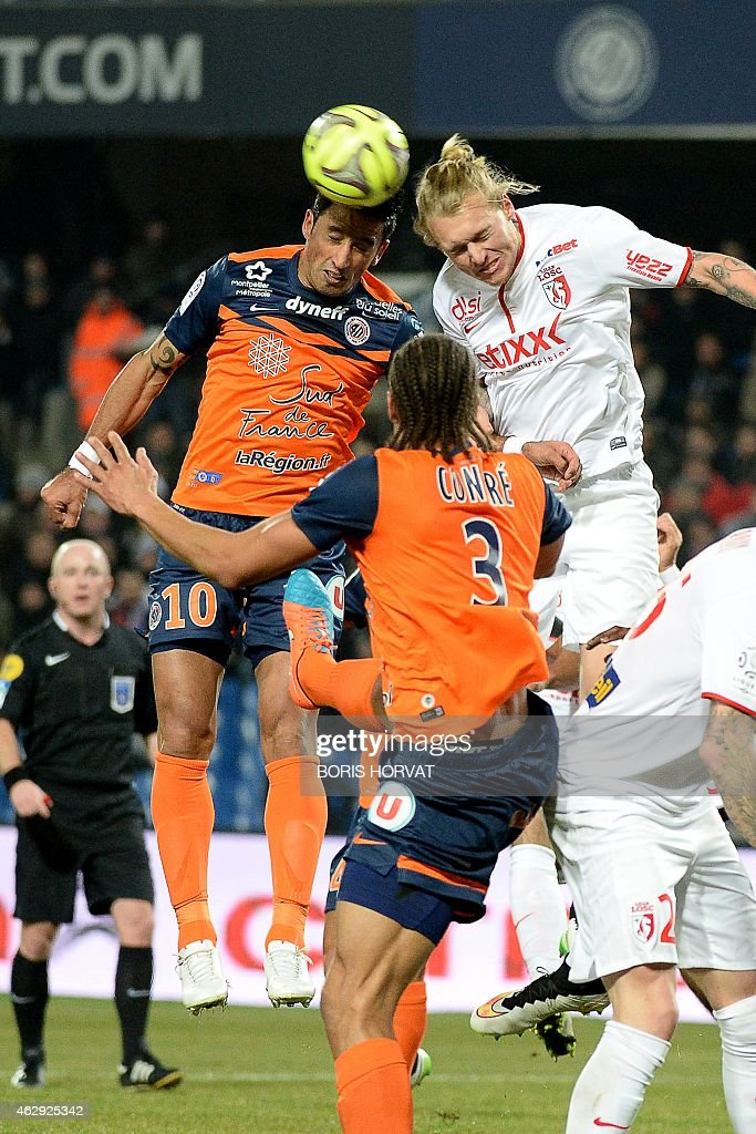 Monpelliers's French midfielder Younes Belhanda (L) and Montpellier's French defender <a gi-track='captionPersonalityLinkClicked' href=/galleries/search?phrase=Daniel+Congre&family=editorial&specificpeople=2167788 ng-click='$event.stopPropagation()'>Daniel Congre</a> (C) vies with Lille's Danish defender <a gi-track='captionPersonalityLinkClicked' href=/galleries/search?phrase=Simon+Kjaer&family=editorial&specificpeople=4895333 ng-click='$event.stopPropagation()'>Simon Kjaer</a> (R) during the French L1 football match Montpellier versus Lille at the Mosson stadium in Montpellier on February 7, 2015. AFP PHOTO / BORIS HORVAT