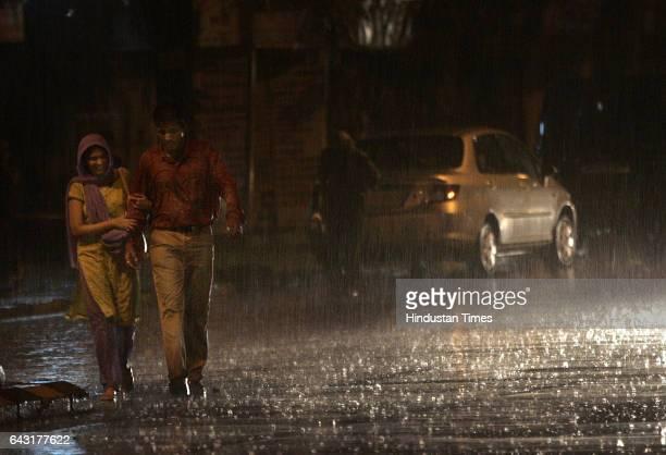 Monsoon A couple walks through rain on Wednesday evening near Siddhivinayak Temple