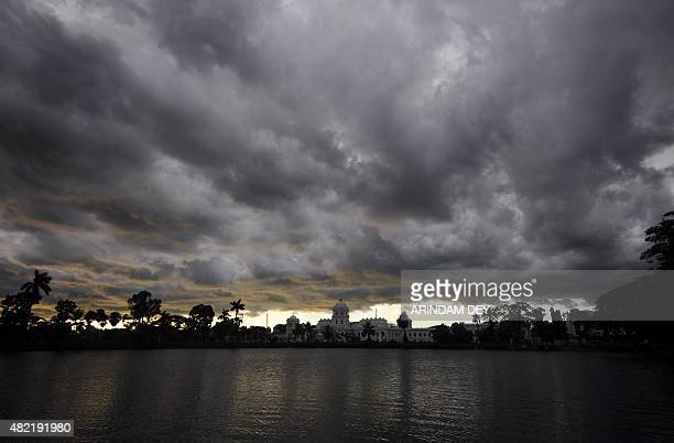 Monsoon storm clouds move over the royal palace in Agartala in the northeastern state of Tripura on July 28 2015 AFP PHOTO/ ARINDAM DEY
