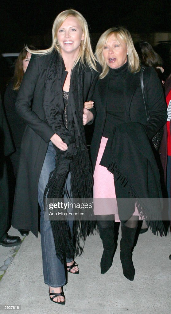 'Monster' actress <a gi-track='captionPersonalityLinkClicked' href=/galleries/search?phrase=Charlize+Theron&family=editorial&specificpeople=171250 ng-click='$event.stopPropagation()'>Charlize Theron</a> (L) and her mother, Gerta Theron, arrive for the <a gi-track='captionPersonalityLinkClicked' href=/galleries/search?phrase=Charlize+Theron&family=editorial&specificpeople=171250 ng-click='$event.stopPropagation()'>Charlize Theron</a> tribute at the 2004 Santa Barbara International Film Festival on February 3, 2004 in Santa Barbara, California.